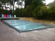This low, telescopic pool cover provides perfect protection and remains discrete